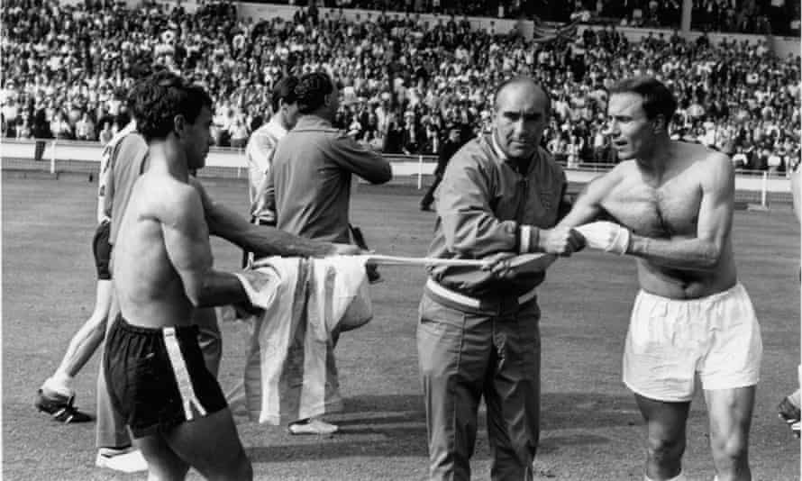 England manager Alf Ramsey prevents George Cohen from swapping his shirt with an Argentina player after the bad tempered World Cup quarter-final at Wembley which England won 1-0.