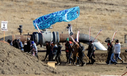 Protesters march along the pipeline route during a protest against the Dakota Access pipeline near the Standing Rock Indian Reservation in November 2016.