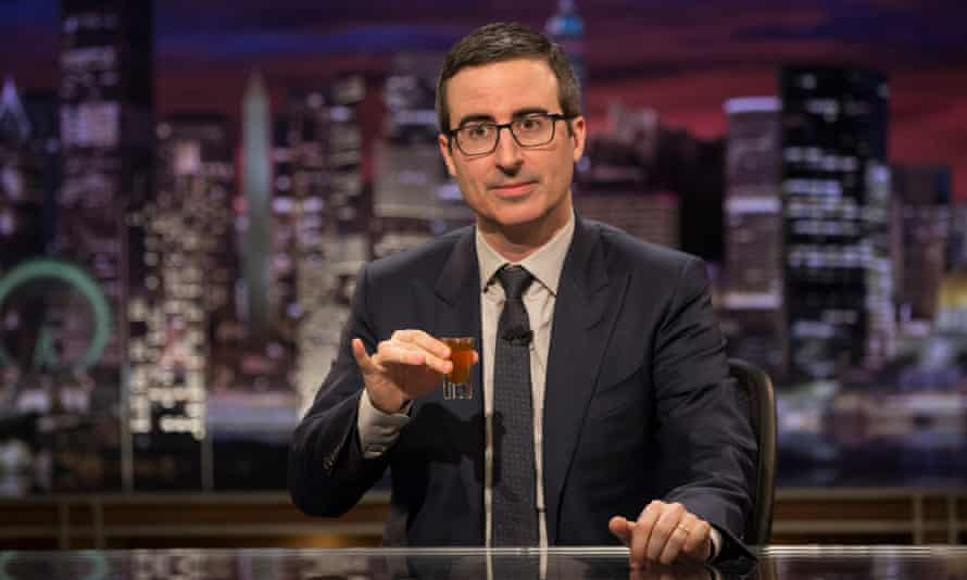 John Oliver with pinky extended.