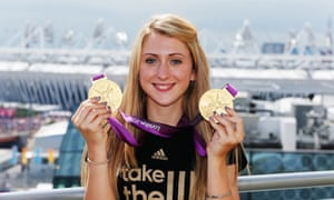 Cyclist Laura Trott poses with her gold medals in 2012.