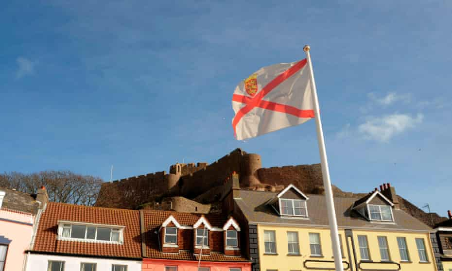 Mont Orgueil Castle behind an island flag at Gorey Harbour in Jersey