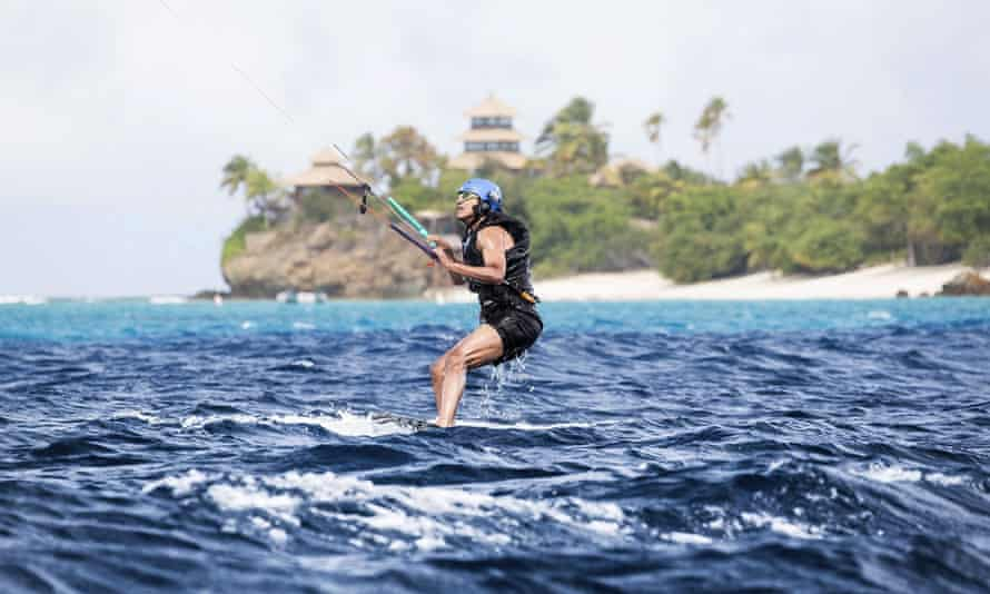 Barack Obama kitesurfs during his stay on Moskito Island, in the British Virgin Islands.