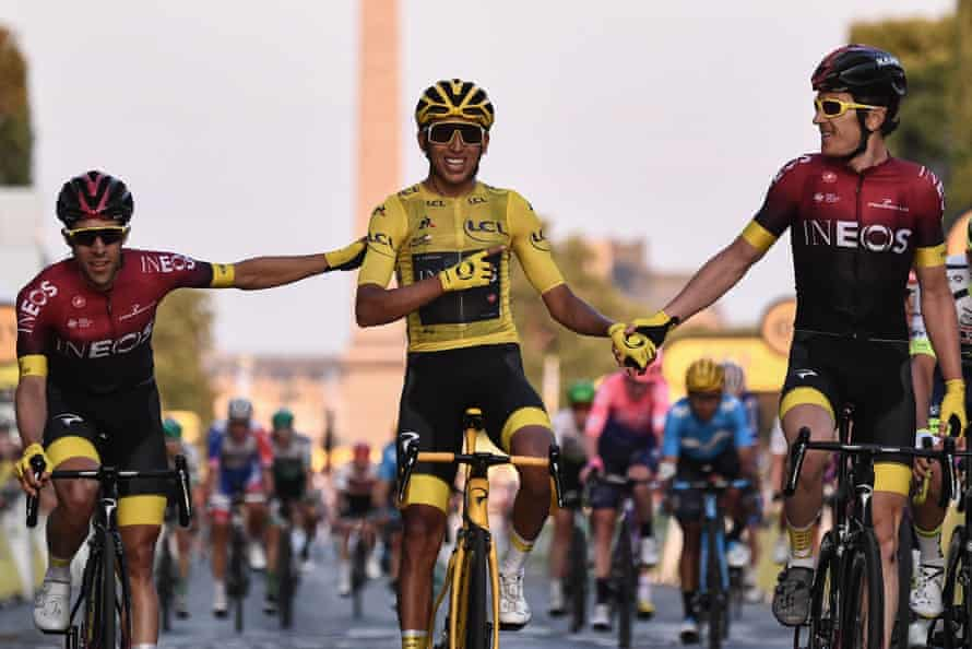 Bernal crosses the finish line in Paris alongside Ineos teammates Jonathan Castroviejo and Geraint Thomas.