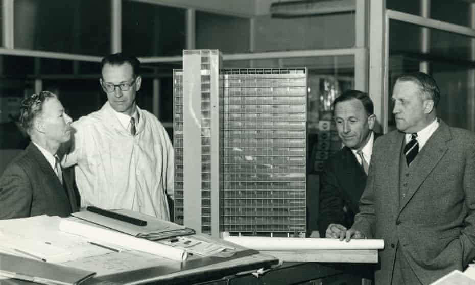 Architect Sir Osborn McCutcheon, second from right, with a model of ICI House.