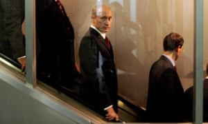 Vladimir Putin uses an escalator between meetings at the world summit of the UN in New York in 2005. His plan to attend for the first time in a decade this September has added spice.
