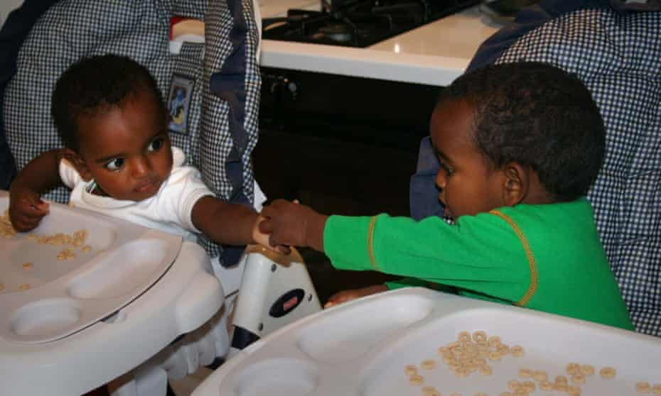 Giulia and Isabella as babies in highchairs
