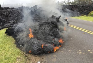 Lava from the Kilauea volcano moves across the road in the Leilani Estates