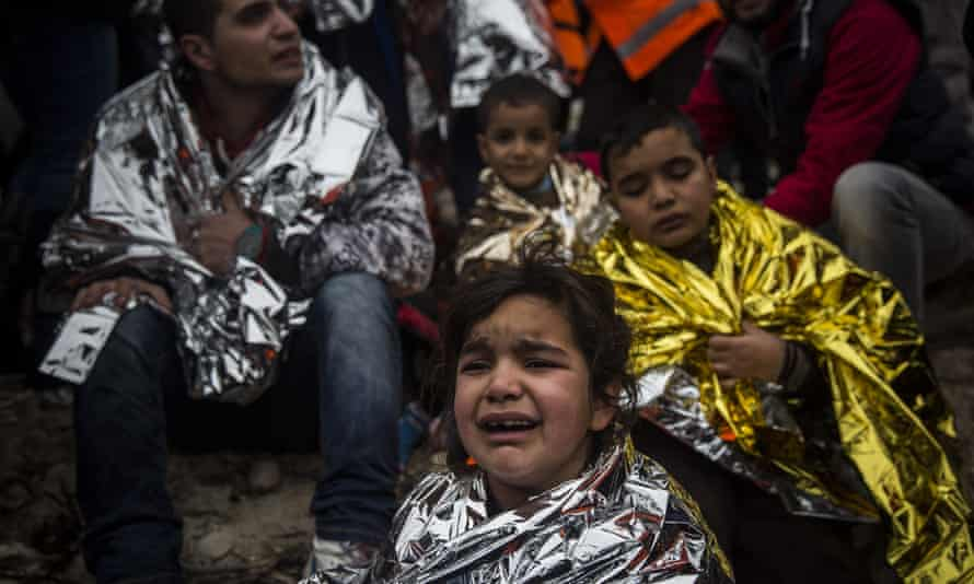 Children and adults in thermal blankets after arriving on Lesbos