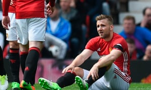 Luke Shaw sits on the Old Trafford pitch after sustaining an injury in Manchester United's 1-1 draw with Swansea City on Sunday