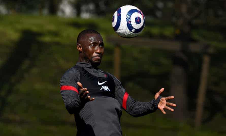 Naby Keita in training, wearing a grey training kit, in the act of heading or controlling the ball
