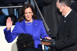 Kamala Harris, flanked by her husband and the second gentleman, Doug Emhoff, is sworn in as vice-president.