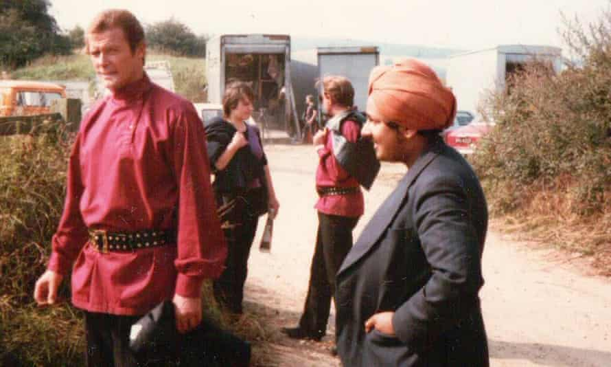 Roger Moore in costume on the set of Octopussy, as Del Singh looks on.