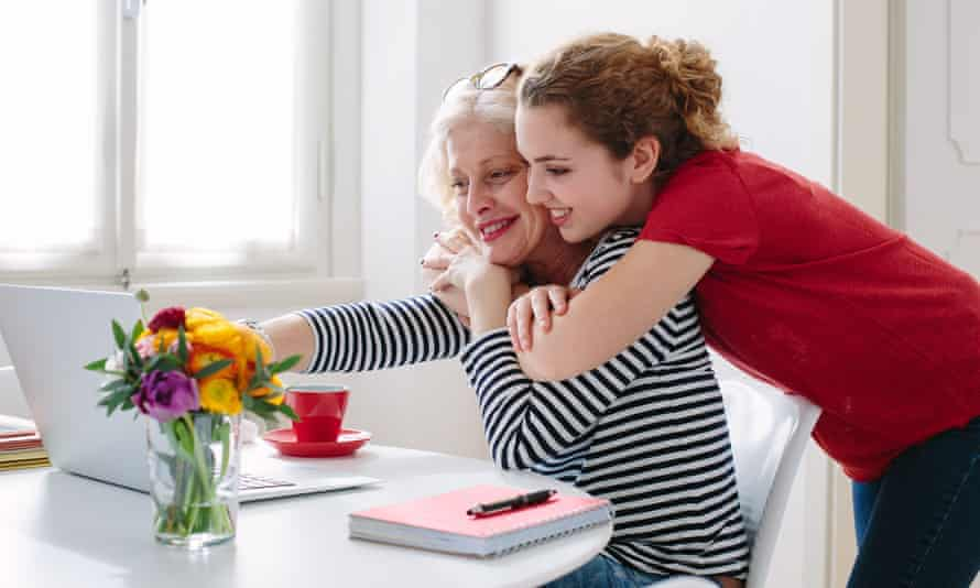 A daughter and her mother both looking happy