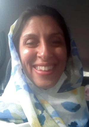 Nazanin Zaghari-Ratcliffe smiling as she travels by car in Tehran, Iran following her release from prison for two weeks.