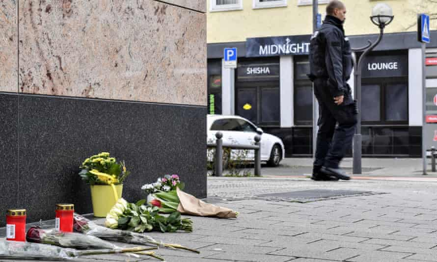 Flowers and tributes in front of the bar in Hanau where nine people were killed.