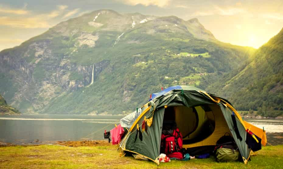 Tent by lake and mountain in Norway