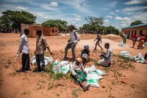 Children chat on arid land in Zambia.