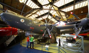 Family looking at aircraft inside the Air and Space Hall at the Museum of Science and Industry in Manchester