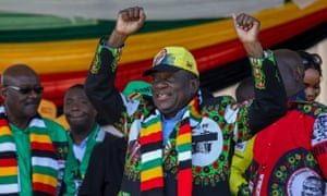 Zimbabwean president Emmerson Mnangagwa greets supporters before the explosion at an election rally in Bulawayo
