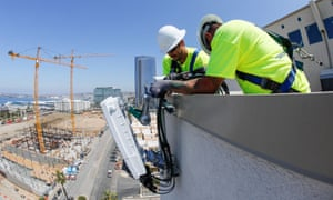Telecoms workers in San Diego install a 5G antenna system