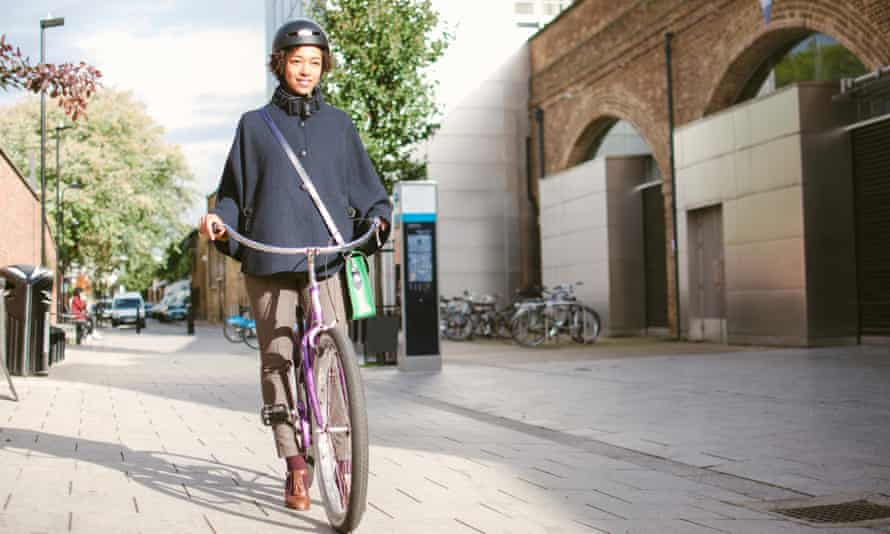 Woman commuting by bicycle.