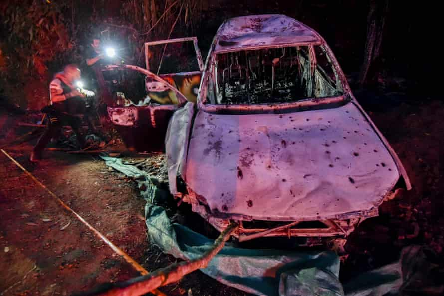 The charred remains of the armoured car in which mayoral candidate Karina Garcia and five others were shot and killed, in a rural area of Suarez, Cauca Department, Colombia.