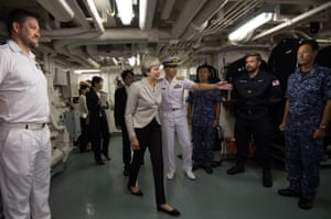 Yokosuka, Japan: Theresa May meets British and Japanese naval personnel on board the Japanese navy's helicopter carrier JS Izumo during a visit to Yokosuka naval base. May is on the second day of a three-day visit to Japan where she is discussing trade and security issues