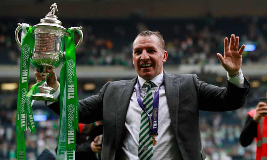 Brendan Rodgers celebrating with the Scottish Cup after victory against Aberdeen