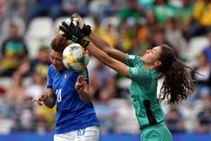 Cristiana Girelli scores her third despite the efforts of Jamaica's goalkeeper Sydney Schneider.