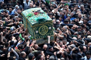 Baghdad, Iraq Shia worshippers carry a symbolic coffin of Imam Mousa al-Kadhim at his shrine to mark the anniversary of his death, in the Kadhimiya district of Baghdad
