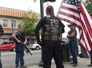 Armed men in Coeur d'Alene, Idaho on Tuesday.