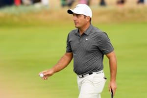 Molinari of Italy reacts to a birdie.