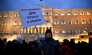 A man takes part in a anti-austerity pro-government demo in front of the parliament in Athens on 11 February, 2015.