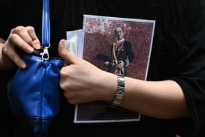 Hong Kong, China A woman holds a booklet with a portrait of late Macau tycoon Stanley Ho as she leaves his funeral