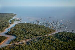 Siem Reap River, Chong Khneas Floating Village, and Tonlé Sap lake, near Siem Reap, Cambodia, in 2015.