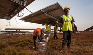 Technicians installing panels in one of East Africa's largest solar farms, Rwamagana District, Rwanda.