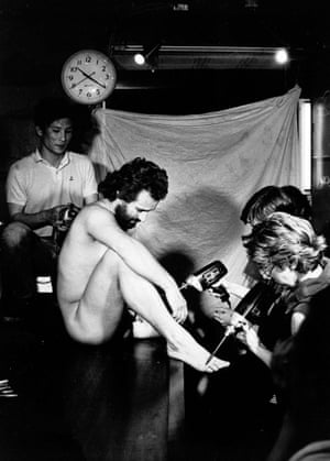 Dragon Ilic getting 'tattooed' by audience using drill with magic markers, 1983