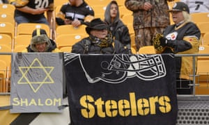 Pittsburgh Steelers fans at an NFL football game on Sunday, the day after the attack.