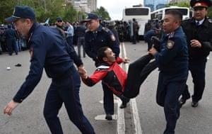 Police officers detain a man in Nur-Sultan, Kazakhstan