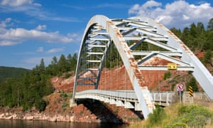 Arched iron suspension bridge along highway US 191 at Flaming Gorge National Recreation Area in Utah, USA.