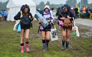 Festivalgoers arrive for the Glastonbury Festival at the Worthy Farm site, Somerset, where heavy rain over a prolonged period has caused isolated flooding and muddy fields