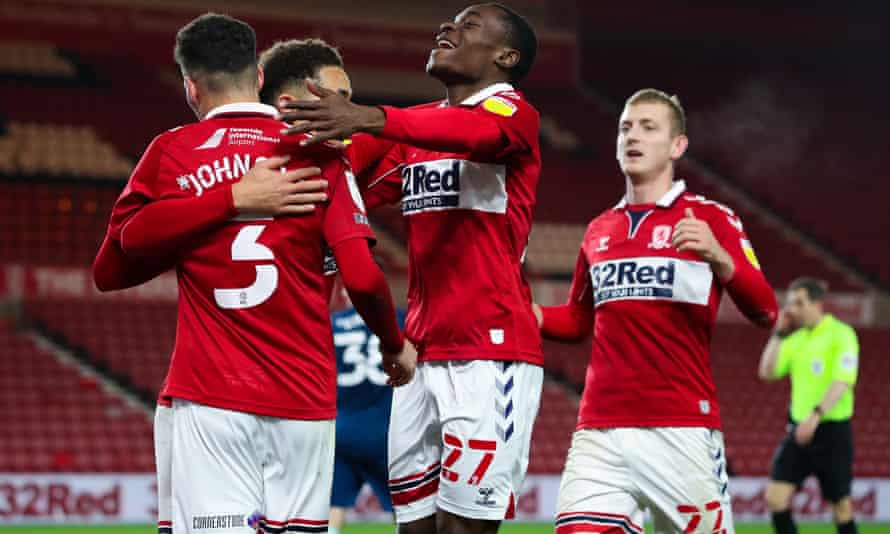 Marcus Tavernier is congratulated by teammates after his shot was diverted in by Matthew Clarke of Derby for Boro's second goal