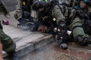 Officers pin a protester to the ground in clashes near government offices in September