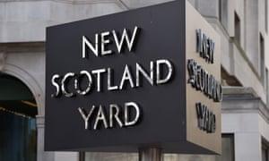 New Scotland Yard logo outside building