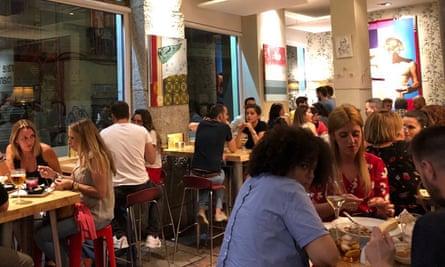 Punters eating at El Bar de Fede, tapas bar Granada, Spain