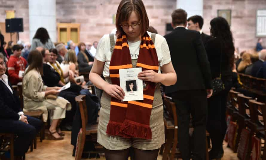 A mourner wearing a Hogwarts scarf holds the order of service for McKee's funeral.