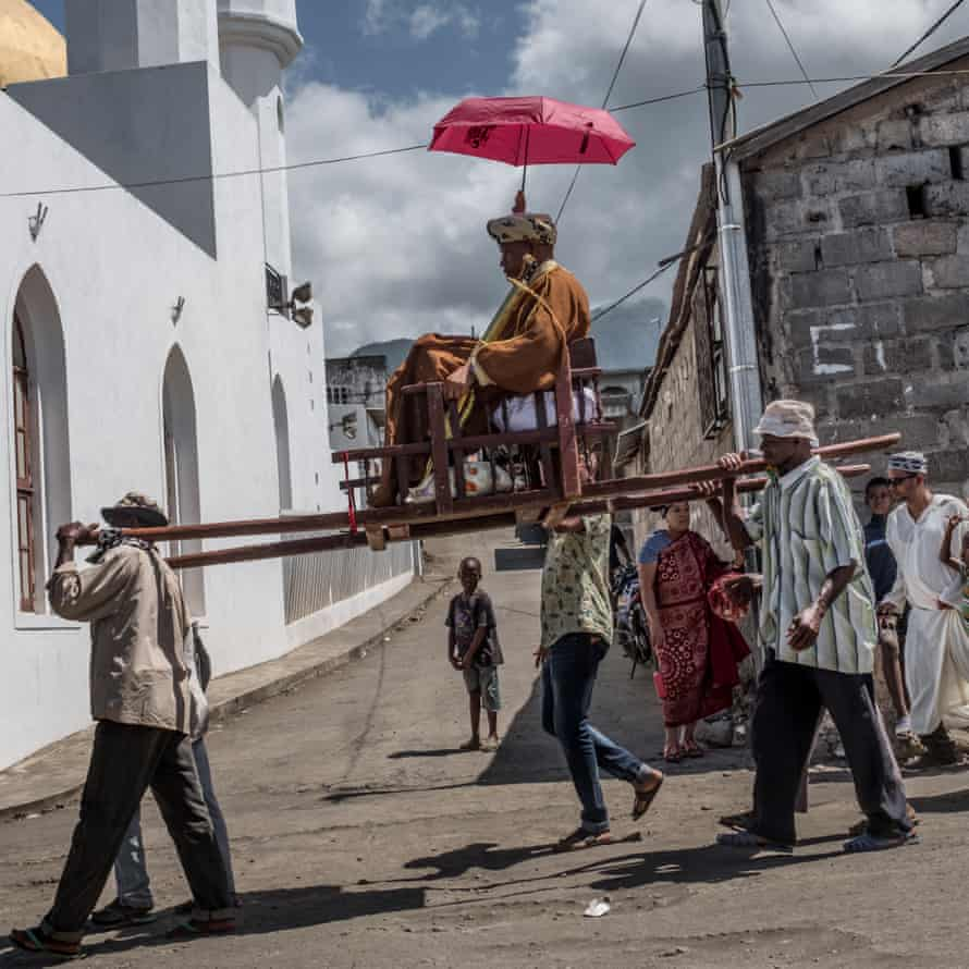The groom is carried through the medina on the eve of the wedding