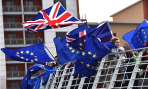 Activists fly flags during a demonstration by fishermen in Newcastle on 15 March against the terms of the current Brexit deal being offered by Britain's Prime Minister Theresa May