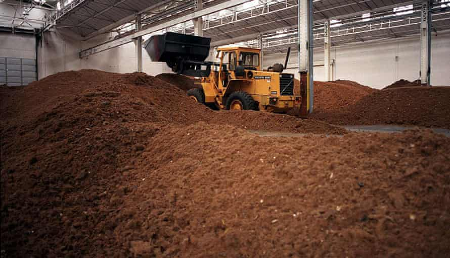 Bulldozer moving a mountain of ground beef.