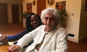 Green Hill, the West Orange Green House facility. Josephine DeLillo with an aide, Marmonie Myers.